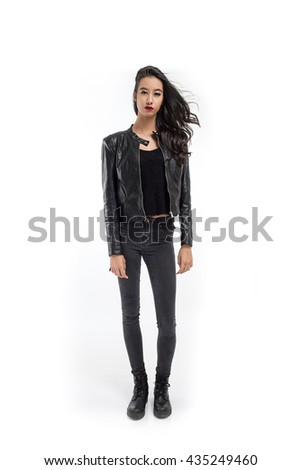 A full body portrait of an attractive young girl dressed in black on white background - stock photo
