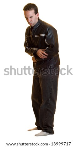 A full body view of a male wearing a black leather jacket and jeans experiencing a stomach ache, isolated on a white background - stock photo