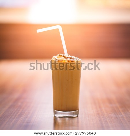 A full glass of chilled Chocolate milk shake at a restaurant. - stock photo