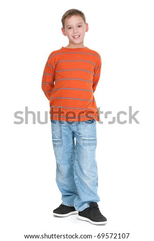 A full height portrait of a boy dressed in casual; isolated on the white background