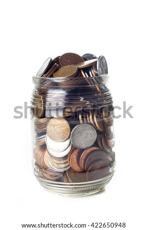 A full jar of Brazilian coins isolated on white background - stock photo