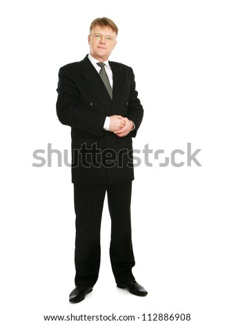 A full-lenght portrait of a businessman standing isolated on white background