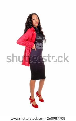 A full length picture of a African American lady in a black skirt and blouseand red jacket, isolated for white background. - stock photo