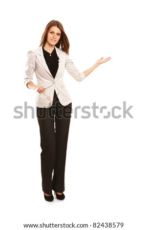 A full-length portrait of a businesswoman displaying with her arm, isolated on white