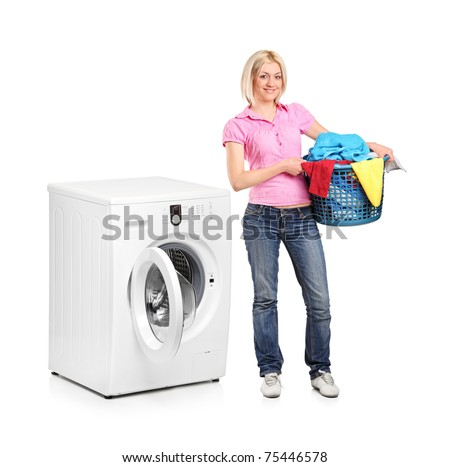 A full length portrait of a woman carrying a laundry basket and washing machine isolated on white background - stock photo