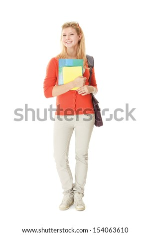 A full-length portrait of a young college girl with books, isolated on white - stock photo