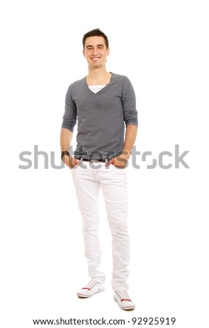 A full-length portrait of a young handsome guy holding hands on pocket, isolated on white background - stock photo
