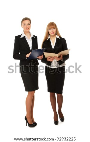 A full-length portrait of successful businesswomen , isolated on white background