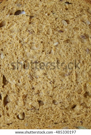 A full page close up of brown wholegrain bread background texture