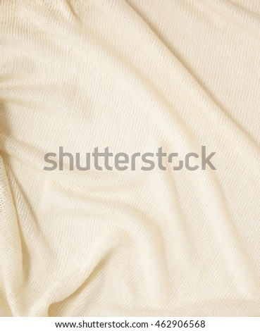A full page of a loose cream knit fabric texture
