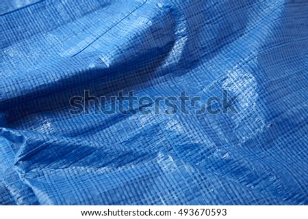 a full page of blue plastic dust sheet background texture