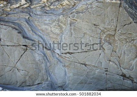 A full page of grey rock background texture with crazed cracks
