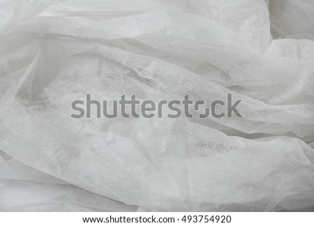 A full page of soft white gardening netting fabric background texture