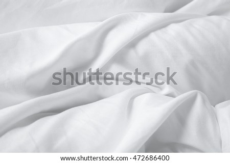 A full page of white creased bedding texture