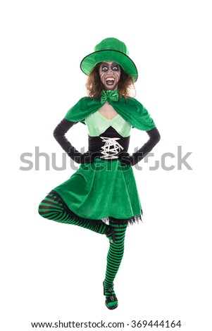 a funny dancing goblin girl, isolated on white, concept ireland and saint patrick´s day