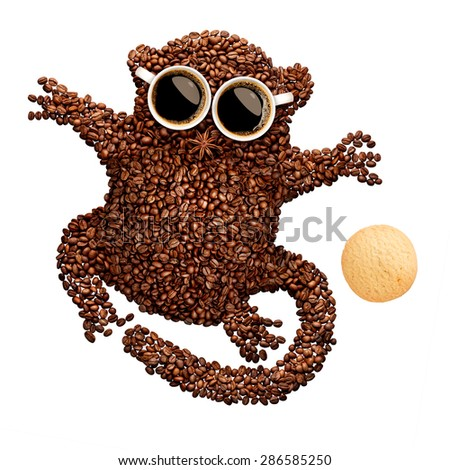 A funny tarsier made of roasted coffee beans, two cups and star anise with an oatmeal cookie, isolated on white. - stock photo