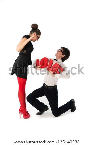 A funny young couple .Nerd,holding  red love letters. - stock photo