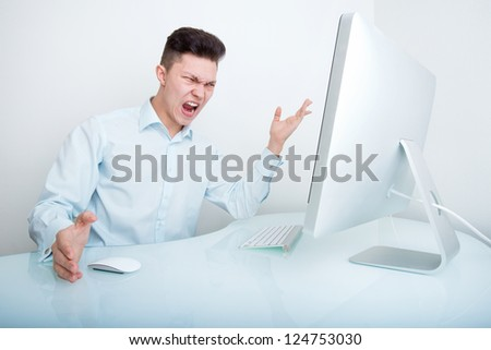 A furious businessman frustrated with his lack of wireless connection and or computer skills - stock photo