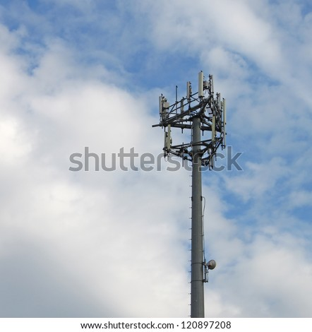 A 4G cell phone, mobile phone, internet and telecommunications tower local base station - stock photo