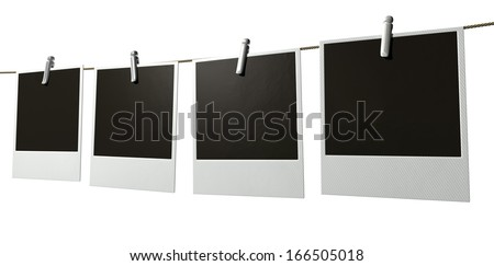A gallery of four blank photographs pegged onto a string on an isolated background - stock photo