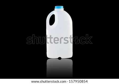 A Gallon Milk isolate on the black background - stock photo