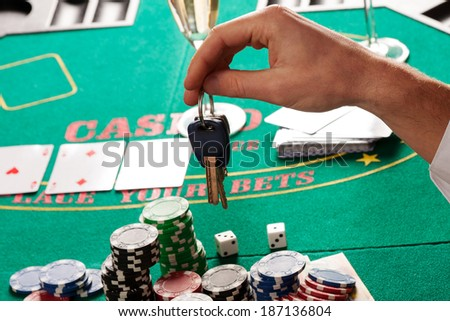 A gambler having to play not to lose his car - stock photo