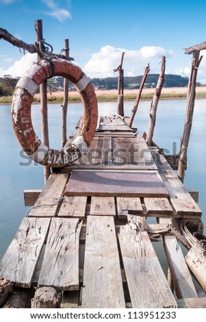 A gangway over the water with a lifebuoy in Asturias (Spain)