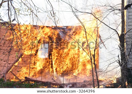 A garage ignited from a house fire in Detroit - stock photo