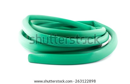 A garden hose isolated on a white background. - stock photo