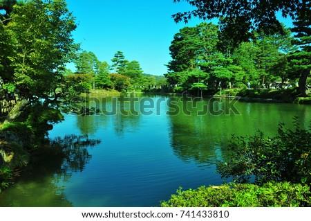 https://thumb1.shutterstock.com/display_pic_with_logo/167494286/741433810/stock-photo-a-garden-in-kanazawa-741433810.jpg