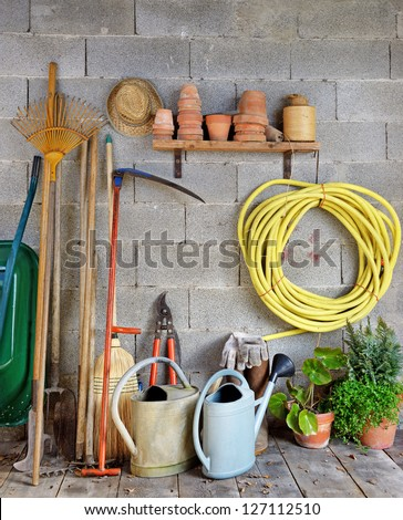 a garden shed with all the tools of the gardener - stock photo
