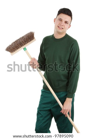 A gardener holding a broom, isolated on white - stock photo