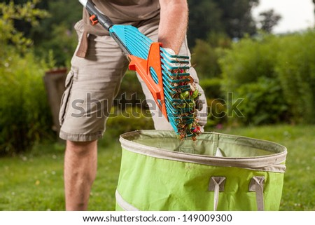 A gardener is going to throw away the old leaves. - stock photo