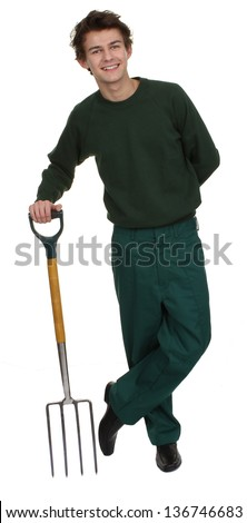 A gardener standing relaxed, holding a fork, isolated on white