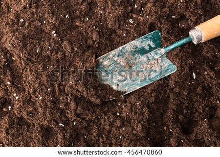 A gardening shovel on a soil background, gardening shovel