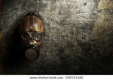 a gas mask hanging on a old concrete wall