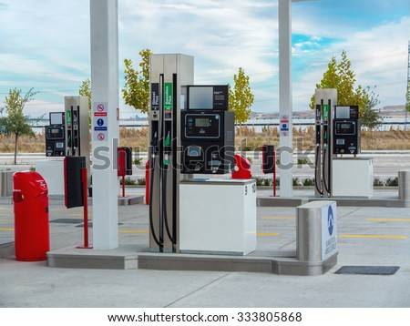 A gas station with some gasoline pump nozzles - stock photo