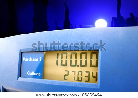 A gasoline station pump showing a sale of $100.00 - stock photo