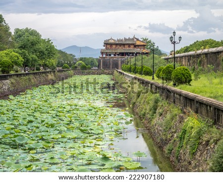 A gate, ditch and wall leading to Emperor's City, Hue, Vietnam - stock photo