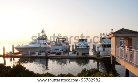 a gate leading to boats docked at san diego harbor - stock photo