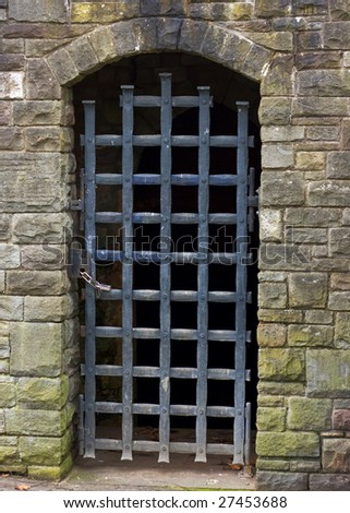 A gated stone entrance doorway in the remains of Bristol Castle UK