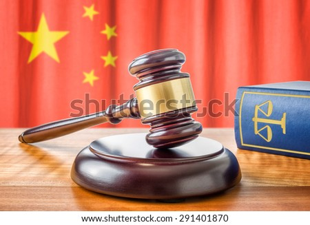 A gavel and a law book - China - stock photo