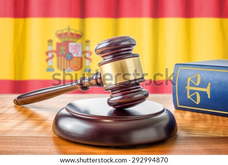 A gavel and a law book - Spain - stock photo