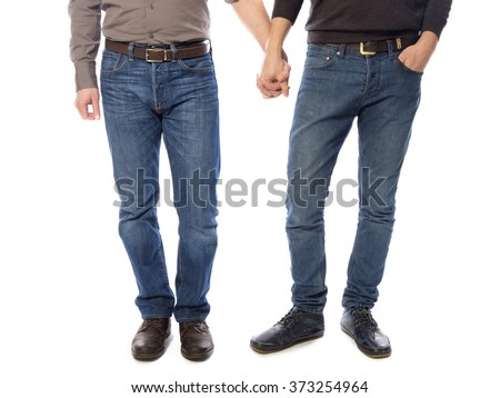 A gay couple holding hands - stock photo