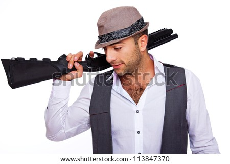 A gentleman is holding a shotgun - stock photo