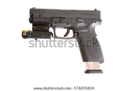 A Genuine Austrian made plastic semiautomatic Handgun with a red dot laser light attached for accuracy and intimidation when aiming at a bad guy. isolated on a white  with room for your text   - stock photo