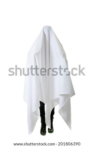 A genuine Human wears a White Sheet over their head and body to pretend to be a Ghost so they can scare people. Isolated on white with room for your text. Ghost are very scary and go Boo a lot. - stock photo