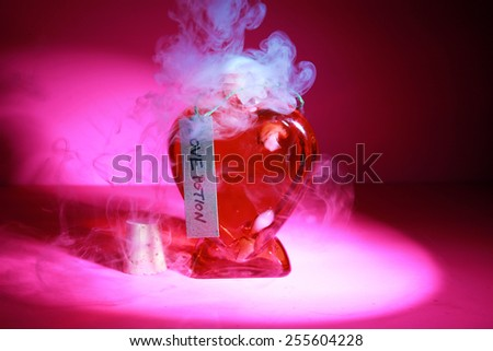 A Genuine LOVE Potion brewed up by a Gypsy, Sorceress, Fortune Teller, Witch, Match Maker, Vixen, or someone who has studied White Magic or the Dark Arts. Love Potions are used around the world. - stock photo