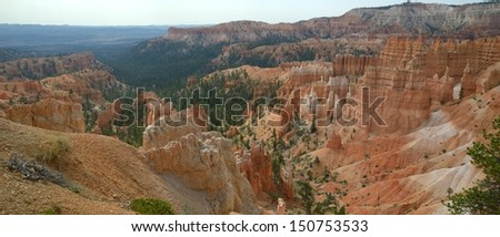 A geological landscape showing intricately patterned features created by wind erosion, and manifesting as what is called Hoodoos, in Bryce Canyon, Utah, USA