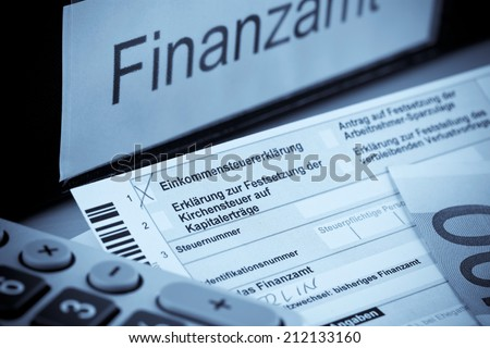 a german tax return for income tax is required. - stock photo